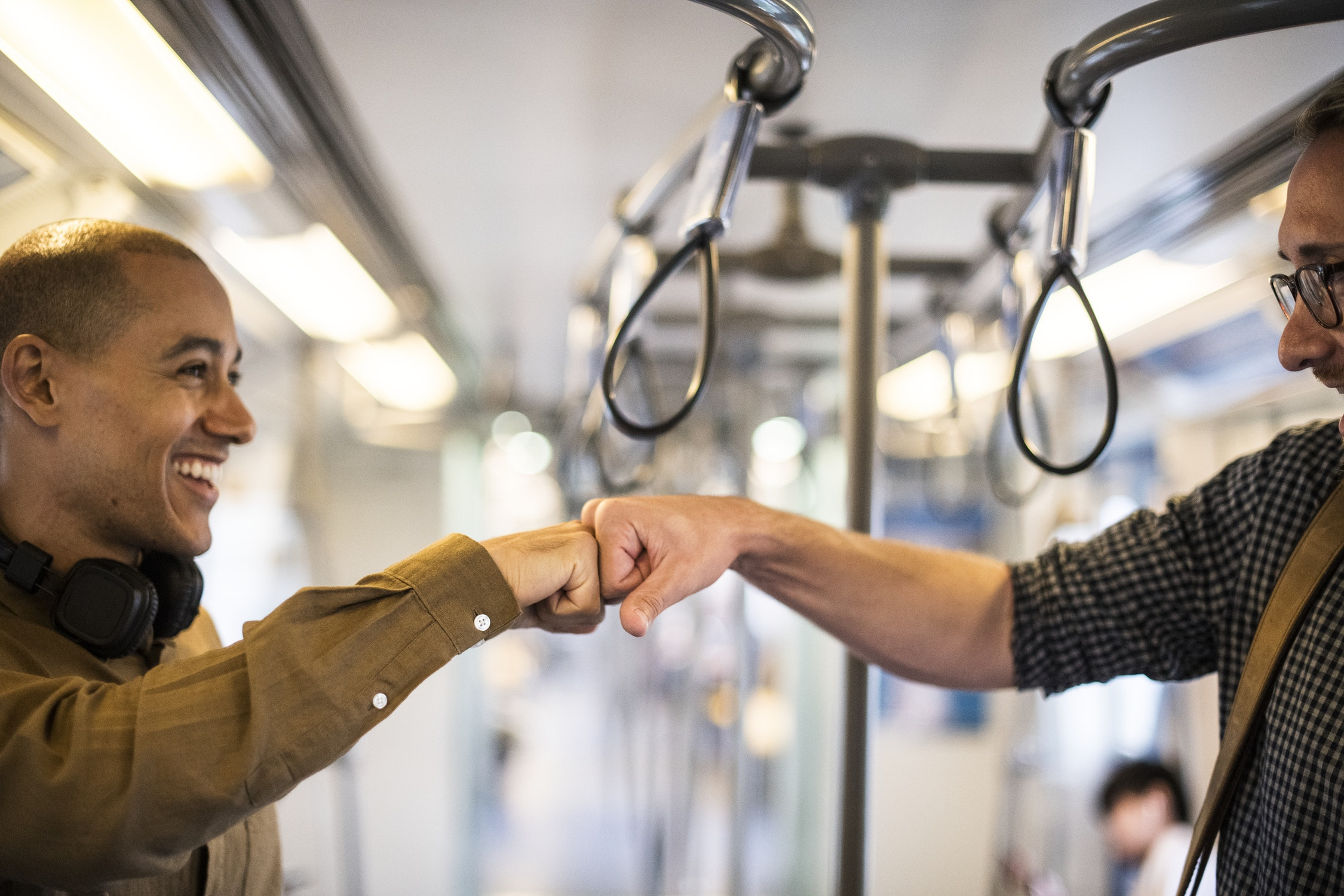 """""""How are you?"""" in Polish — two men greeting on a subway"""