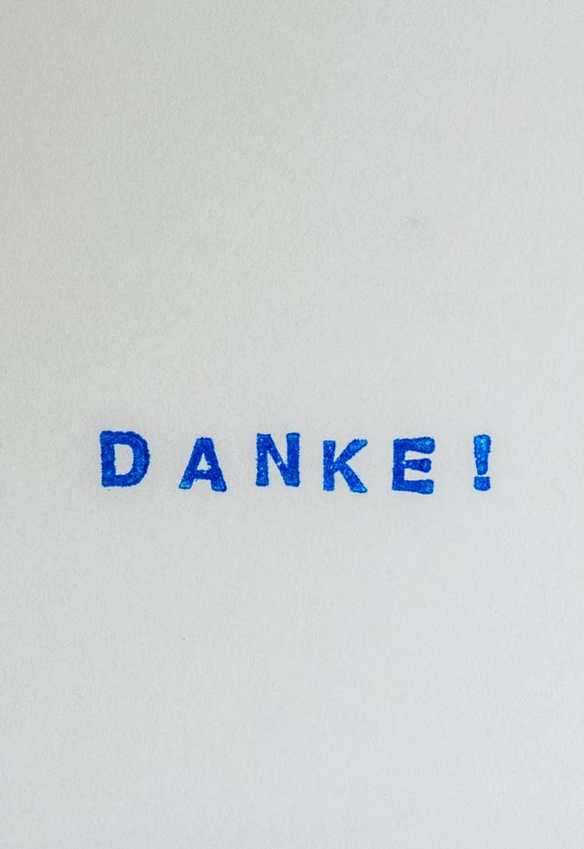 """""""Danke!"""" (""""thank you"""" in German) writter in bold letters in pen"""